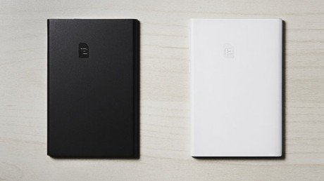 Piece SIM card adapter adds additional SIM card to smartphone. e1451696908224